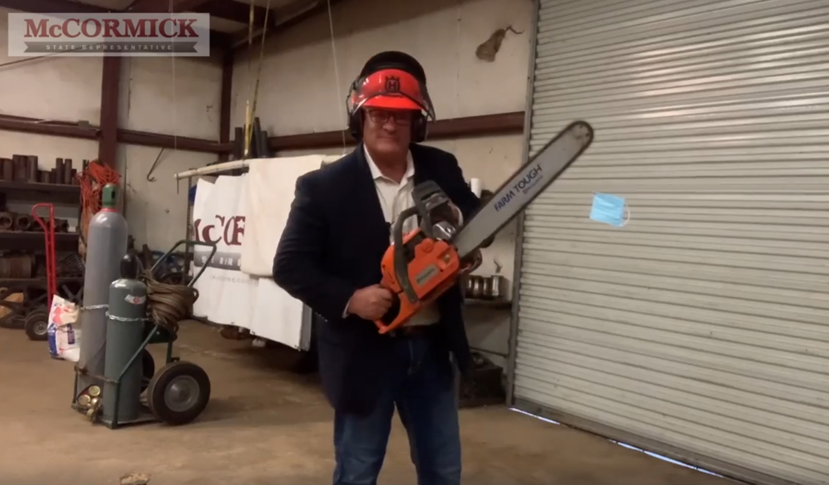 Rep. Danny McCormick takes a chainsaw to a photoshopped mask