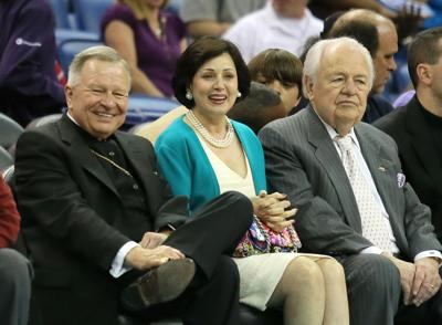 Archbishop Gregory Aymond and Gayle and Tom Benson