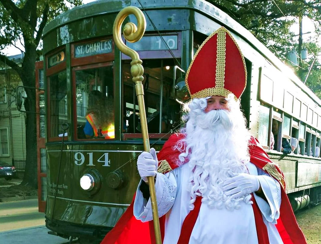 Todd van Alstyne as St. Nicolas brings the Christmas spirit to St. Charles Ave.