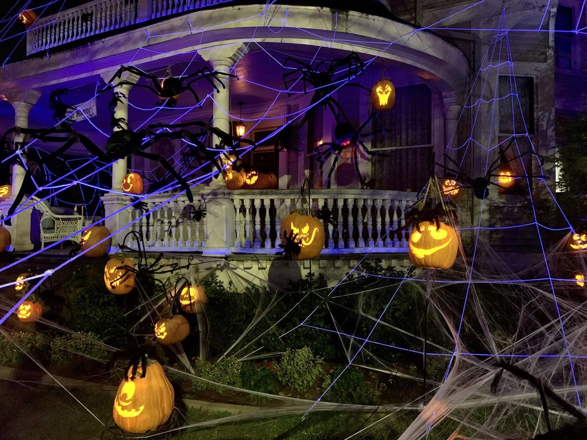 The 'Ghost Manor' at 2502 Magazine St. features a spidery new theme in 2020..jpeg