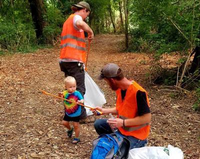 Volunteers pick up trash