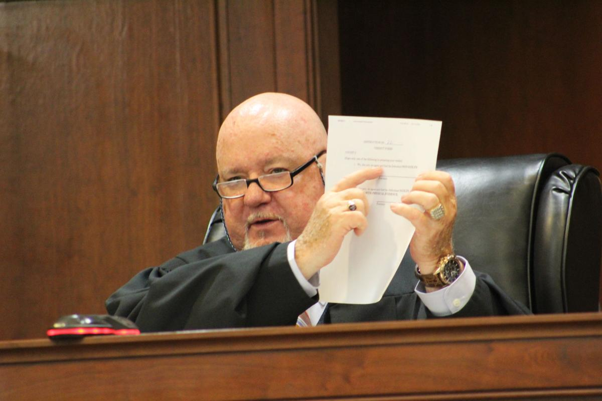 Judge Oscar Gayle House provides instructions to the jurors.JPG