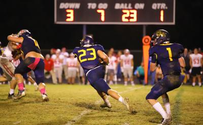 Brenton Willoughby rushes the ball against Corbin