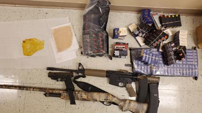 Drugs, money, guns confiscated in arrest