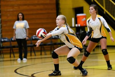 Deaton, Hensley lead Tiger volleyball to win