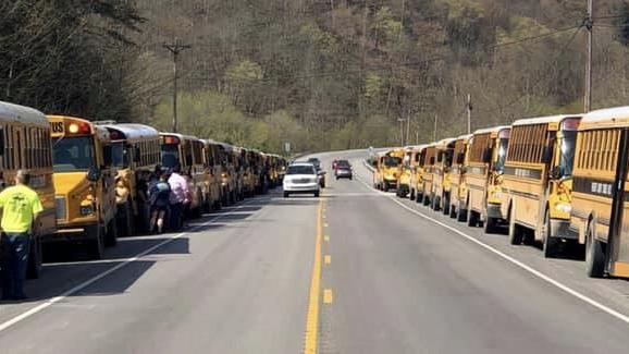 Breathitt bus line-up, pays respects to fallen driver