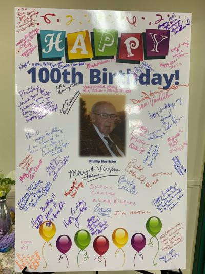 Friends and family sign 100th birthday poster