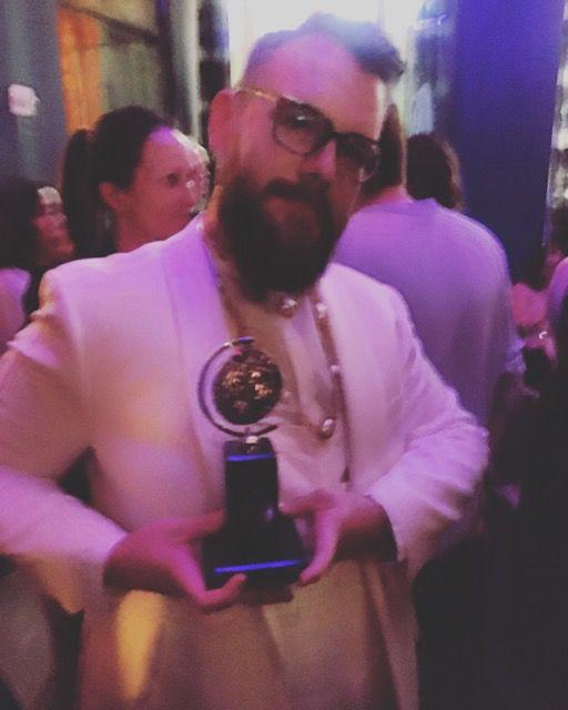 Caleb Hammons with Tony Award