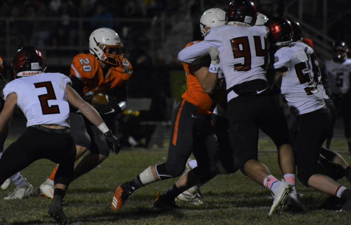 Caden Nelson of Oakland-Craig carries the ball during Friday's 50-16 win over Doniphan-Trumbull in Oakland.