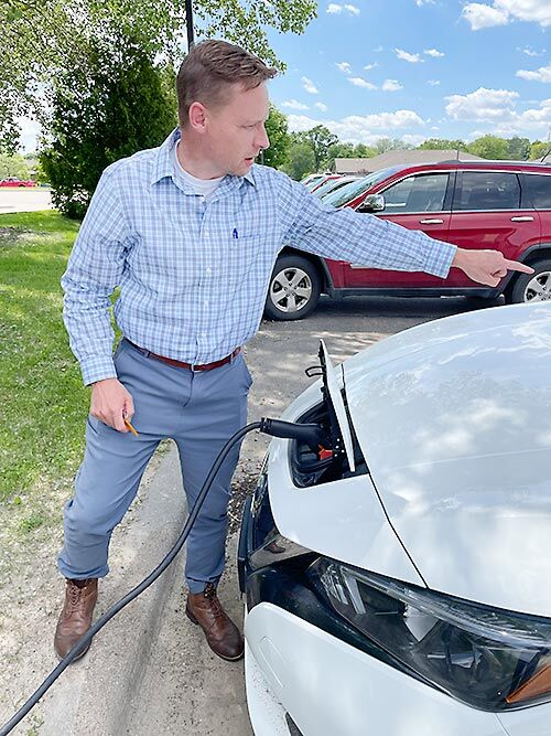 Lyle Lutt charges electric vehicle