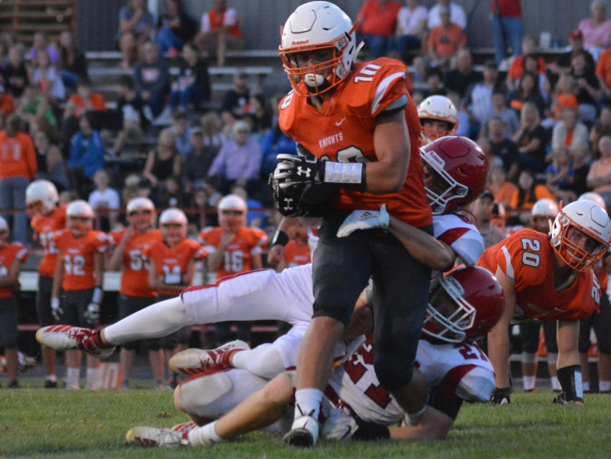 Blake Johnson of Oakland-Craig carries the ball during the Knights' 50-13 win over Hartington Cedar Catholic on Friday.