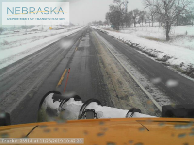 Snow plow cleaning the road near Bridgeport