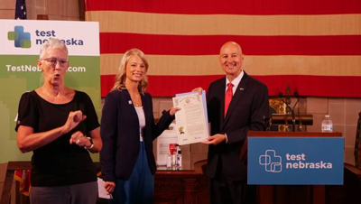 Gov. Ricketts presents Andrea Dorsey with the official proclamation designating  Nebraska as a Hidden Heroes state.