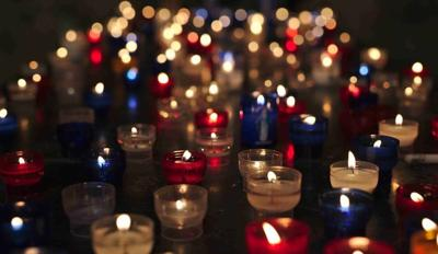 red white blue candles obit.jpg