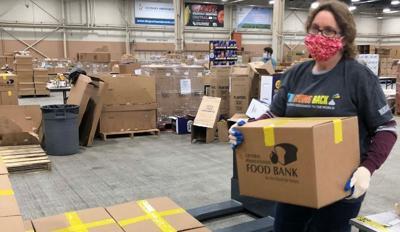 Foodbank_womancarryingbox_2021.jpg