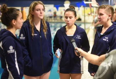 Berwick singers make impact in water and out as they sing Anthem to kick off every meet of the season