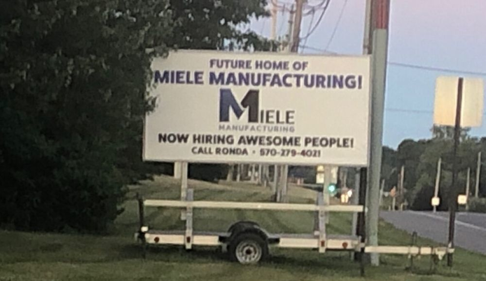 Miele Manufacturing sign outside of Gander Outdoors _ 2020
