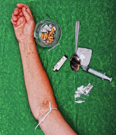 Drugs addict activities and some tools on table