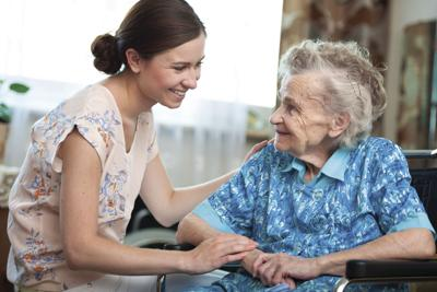 Stock Elderly woman and caregiver