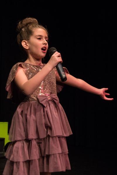 Logan Marber sings at event