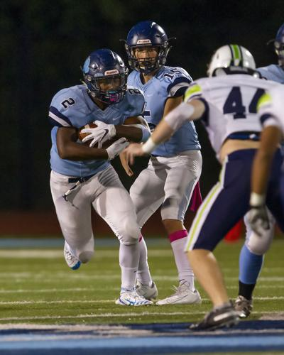 ON THE COVER | Cambridge running back takes a hand off