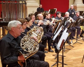 Members of the Atlanta Wind Symphony brass section.