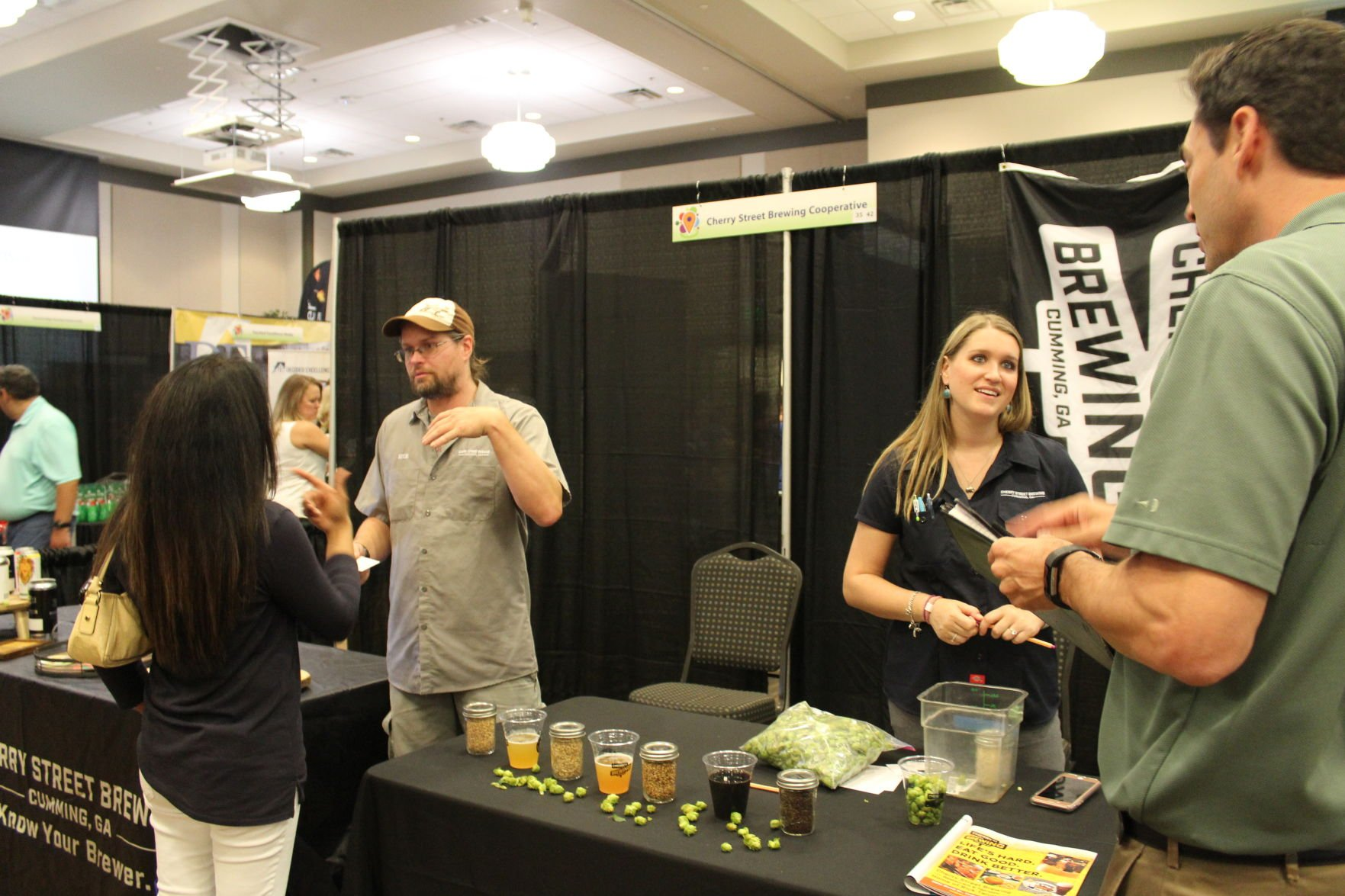 Cherry Street Brewing Owners Nick And Alisa Tanner Talk To The Public About  Their Business.