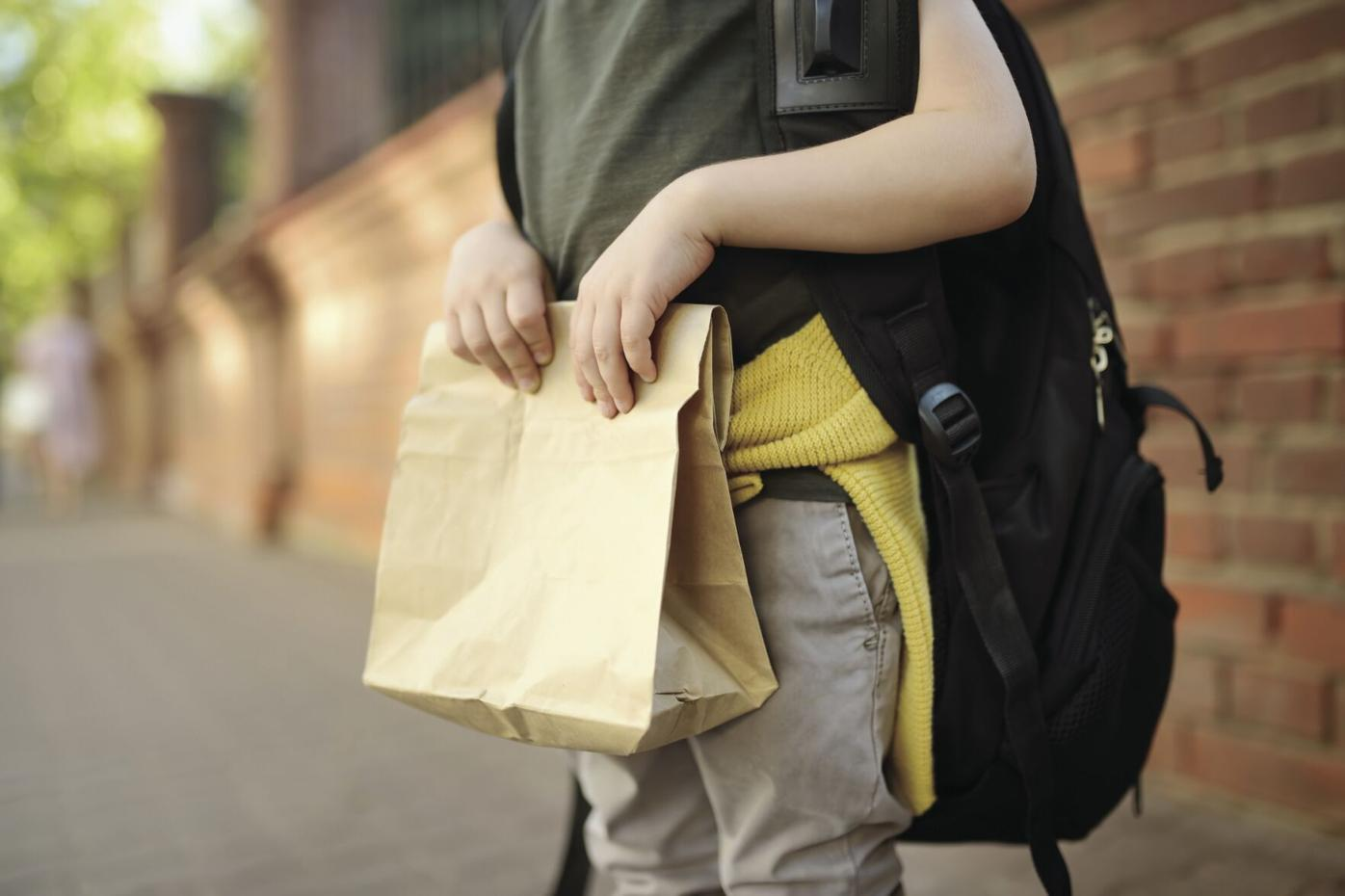 Student with big backpack and lunch bag
