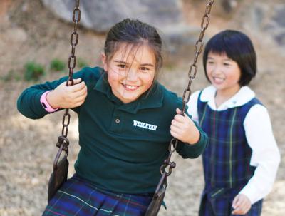 Girls on swing at Weslyan