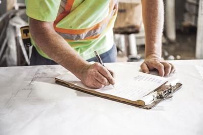 STOCK construction worker signs clipboard