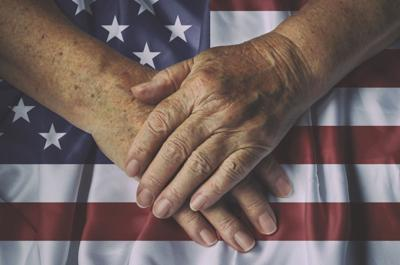 STOCK hands crossed over flag