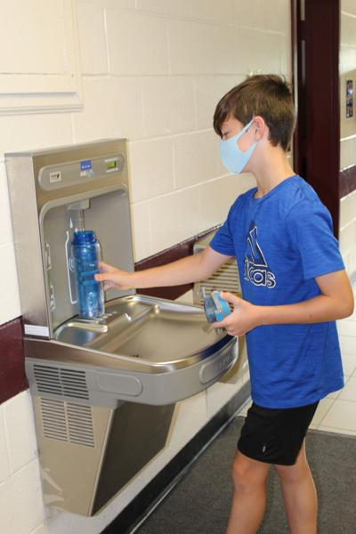 student using water station