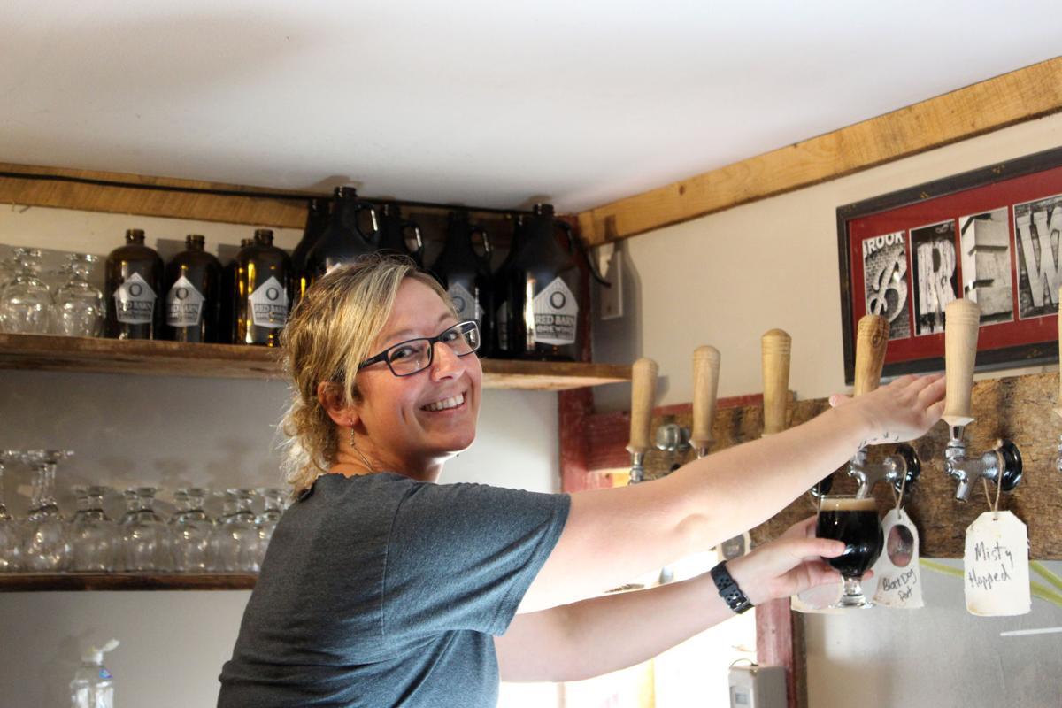 Jenna Hurd pouring a glass of Black Dog Porter.jpg