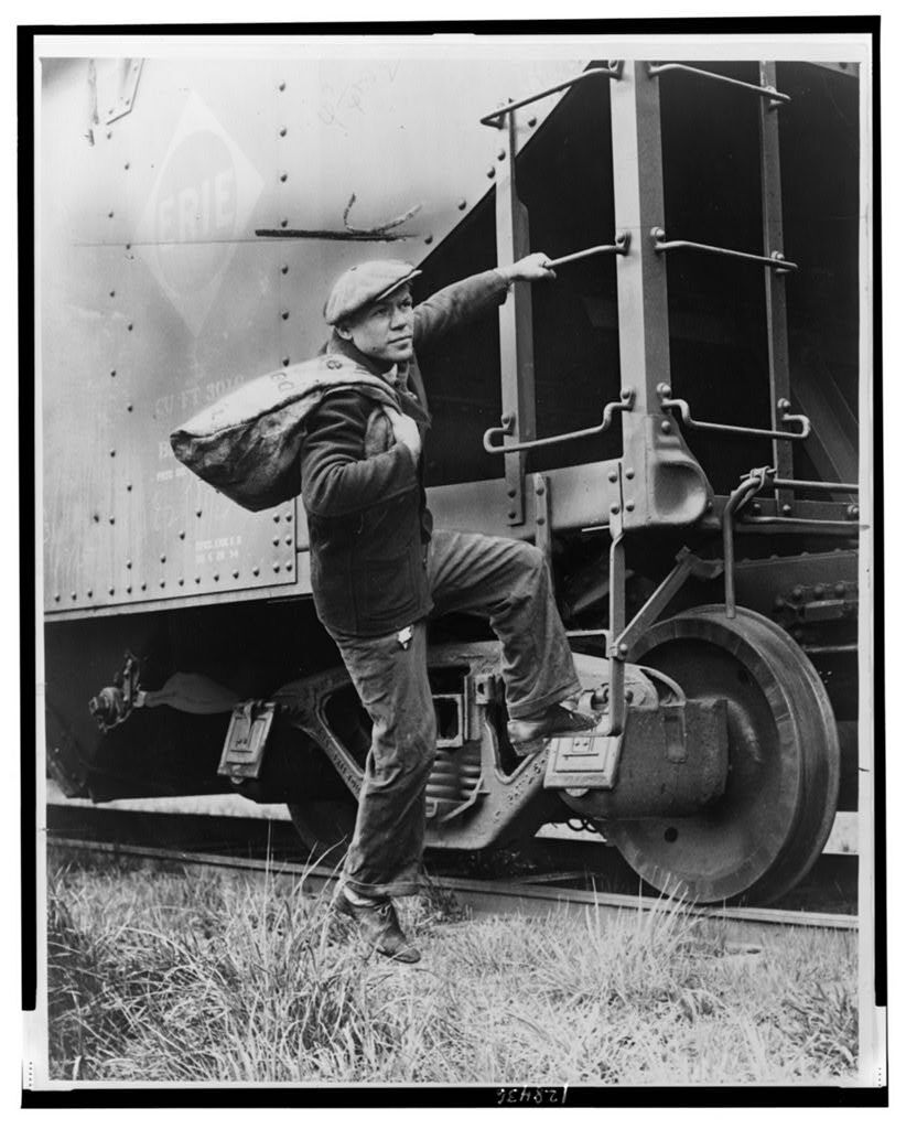 LOC Lou Ambers mounting the ladder of a train car.jpg