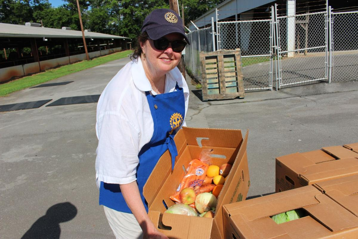 Civic clubs hand out fresh fruits and vegetables at Coosa Valley Fairgrounds
