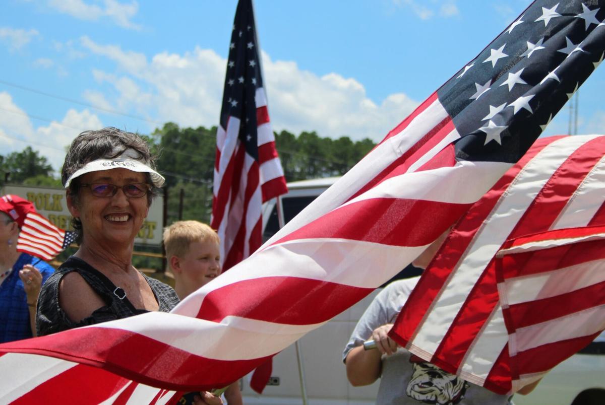 Flag waving event promotes pride, patriotism
