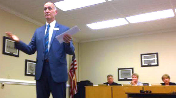 Raines at school board meeting