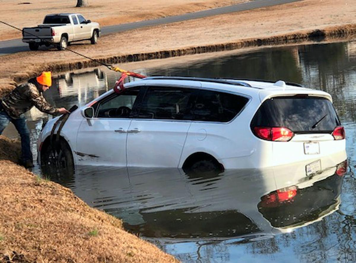 Driver falls asleep before going into Mundy's Lake
