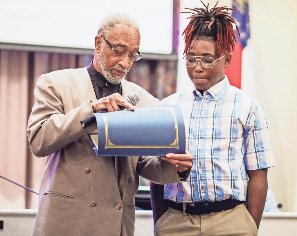 BOE honors student for stopping a bully's attack