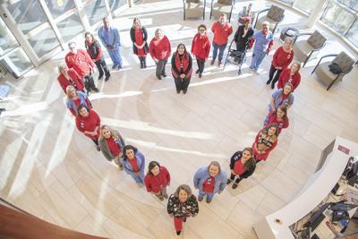 AdventHealth team members wear red for women