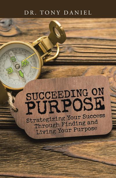 "Signing for Tony Daniel's book ""Succeeding on purpose: Strategizing your success through finding and living your purpose"""
