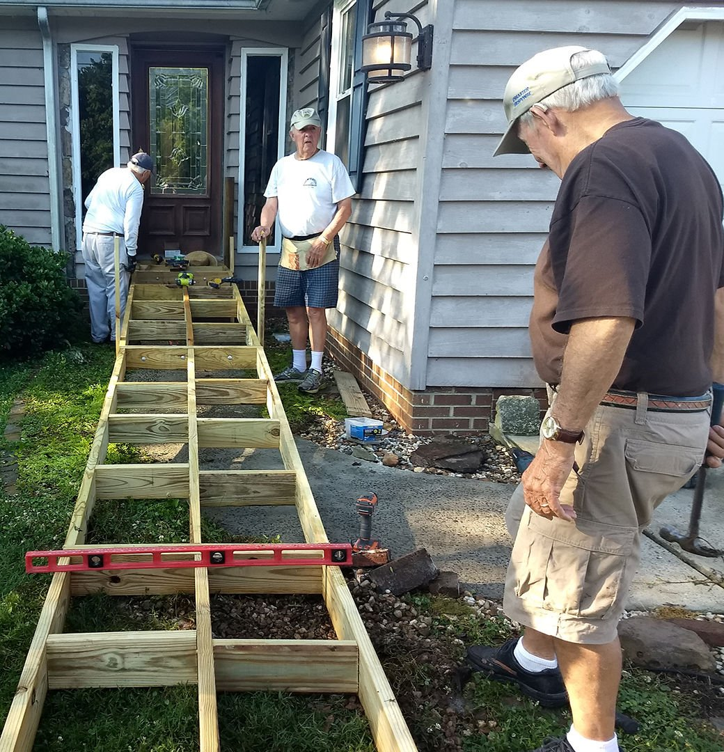 Ramping up collaboration: Volunteers help build access ramp for Hamilton Hospice patient