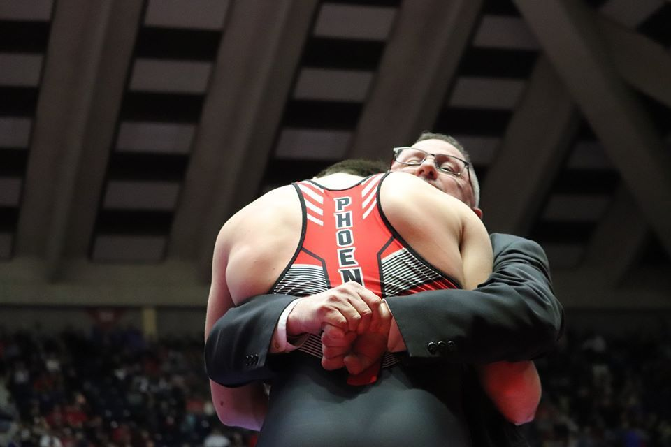 Sonoraville's Randy Steward hug with Jeb Knight
