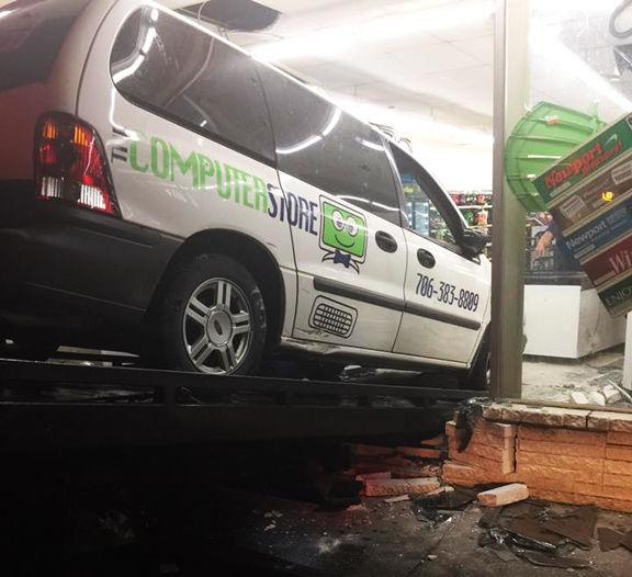 Car crashes into Dollar General on North Wall Street