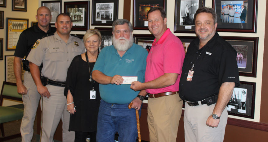 Sheriff's Auxiliary donates to Winner's Club