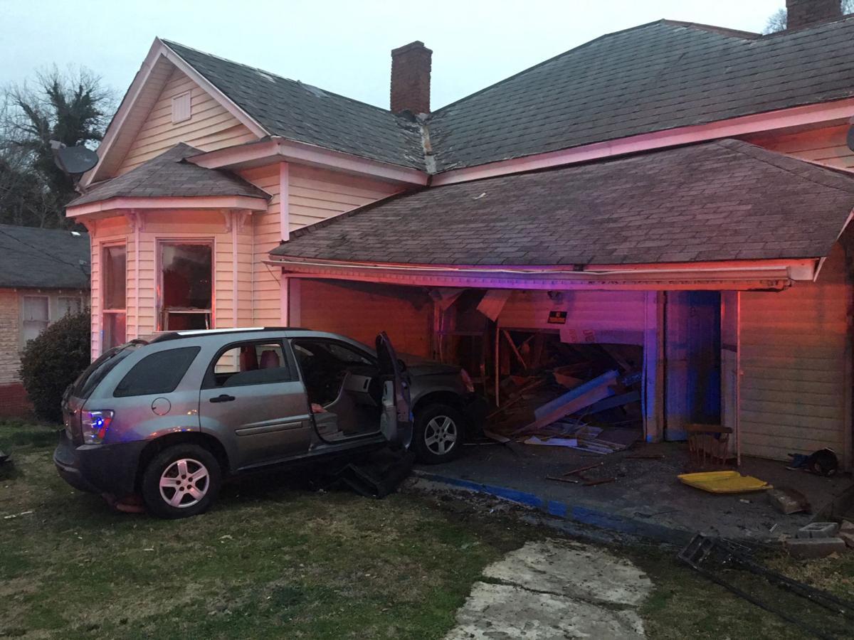 Car strikes house on Harvey Street