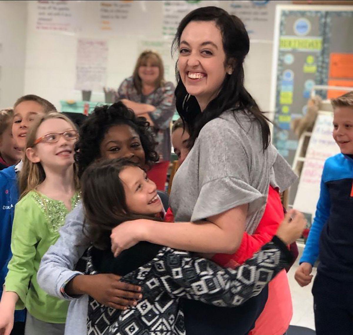 Student congratulates Teacher of the Year