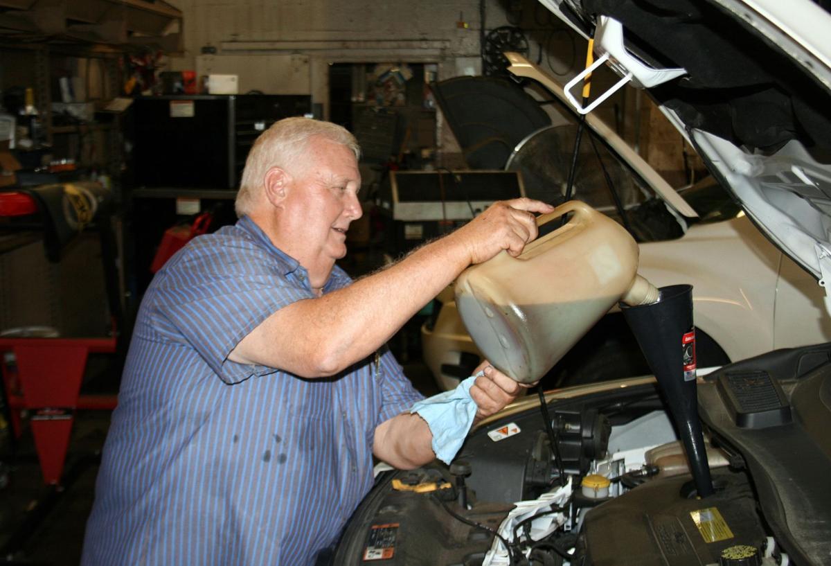 Dennis Ratliff works on oil change