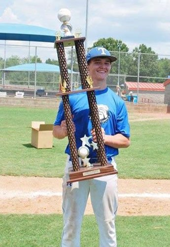 Jacob Cornette with World Series trophy