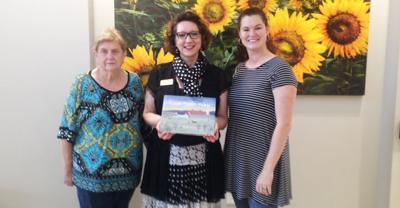 Georgia Farm Bureau Foundation donates book about farm life to local library